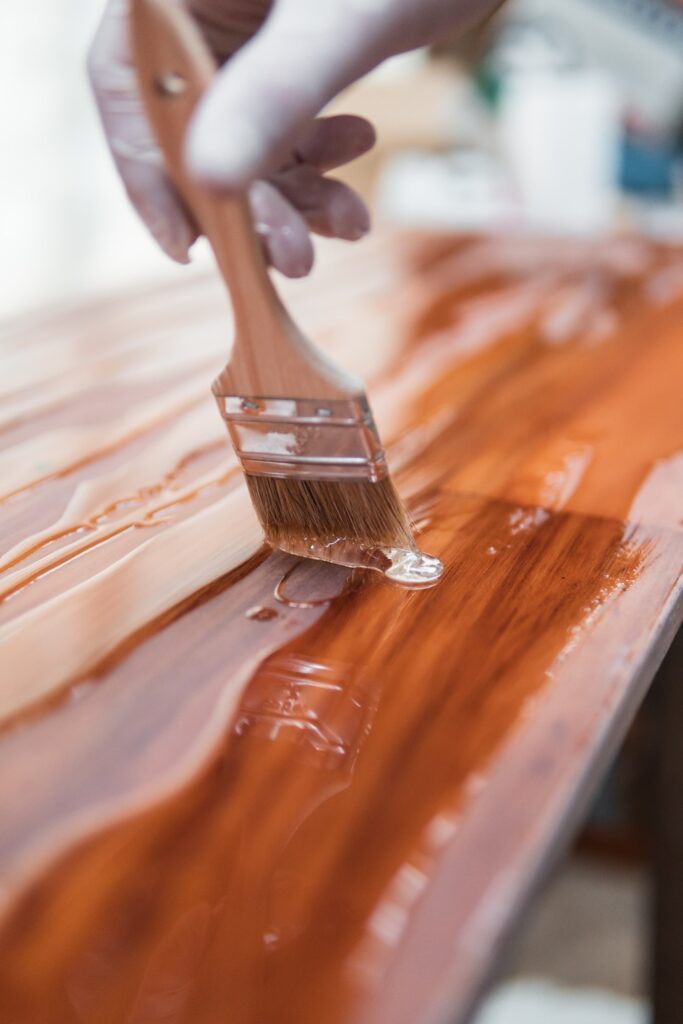 painting a table with paint brush